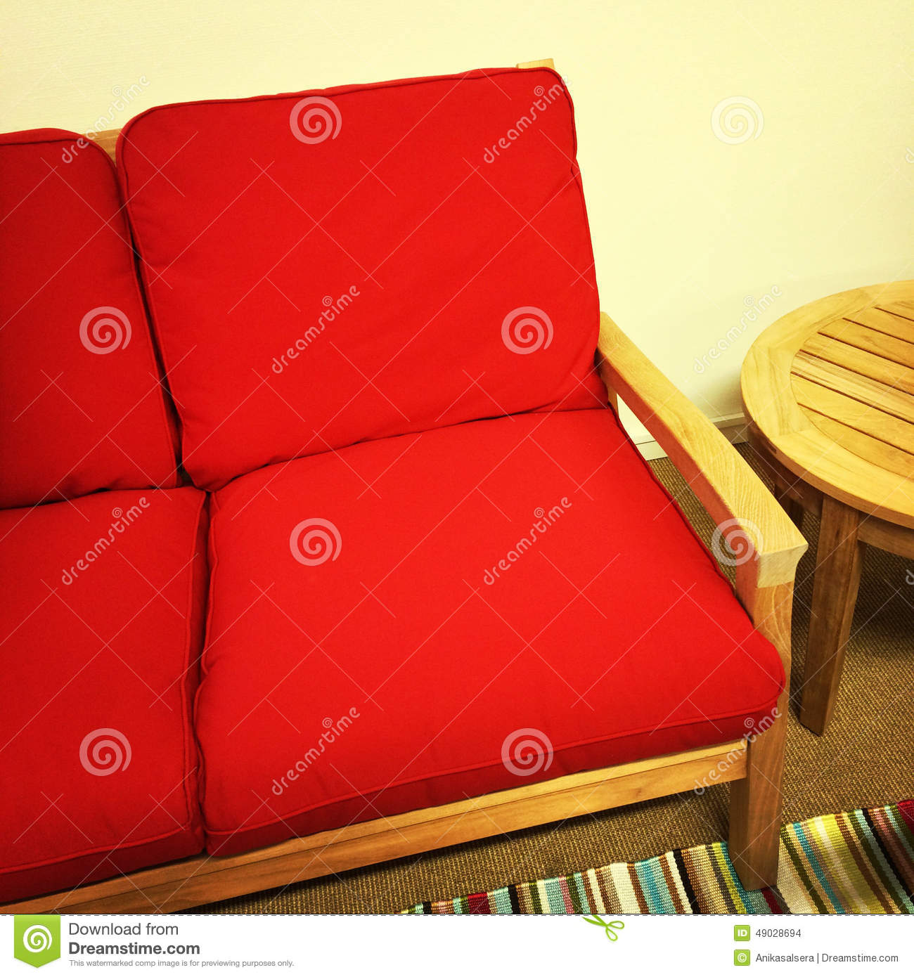 Excellent Red Sofa And Wooden Table Stock Photo Image Of Bright Download Free Architecture Designs Scobabritishbridgeorg
