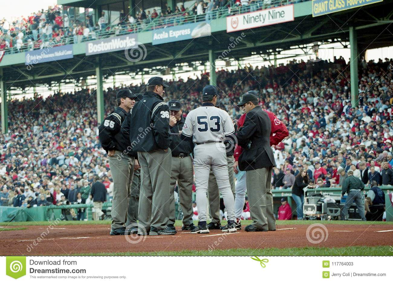 Red Sox and Yankees coaches meet at homeplate before Game 3 of the 2003 ALCS