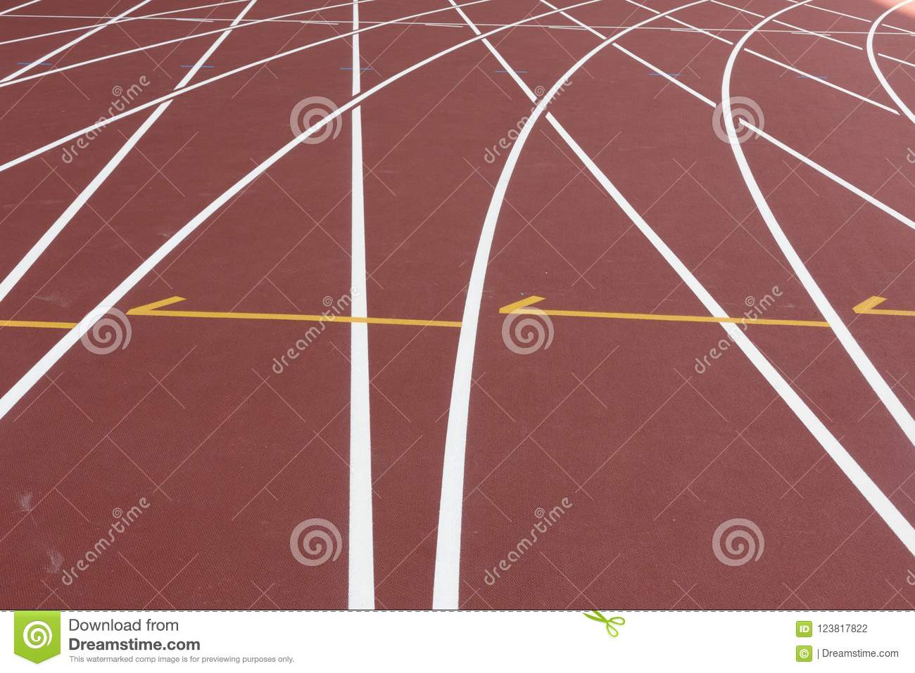 Red sport track for running on stadium shot on turn. Running healthy lifestyle concept. Sports background abstract