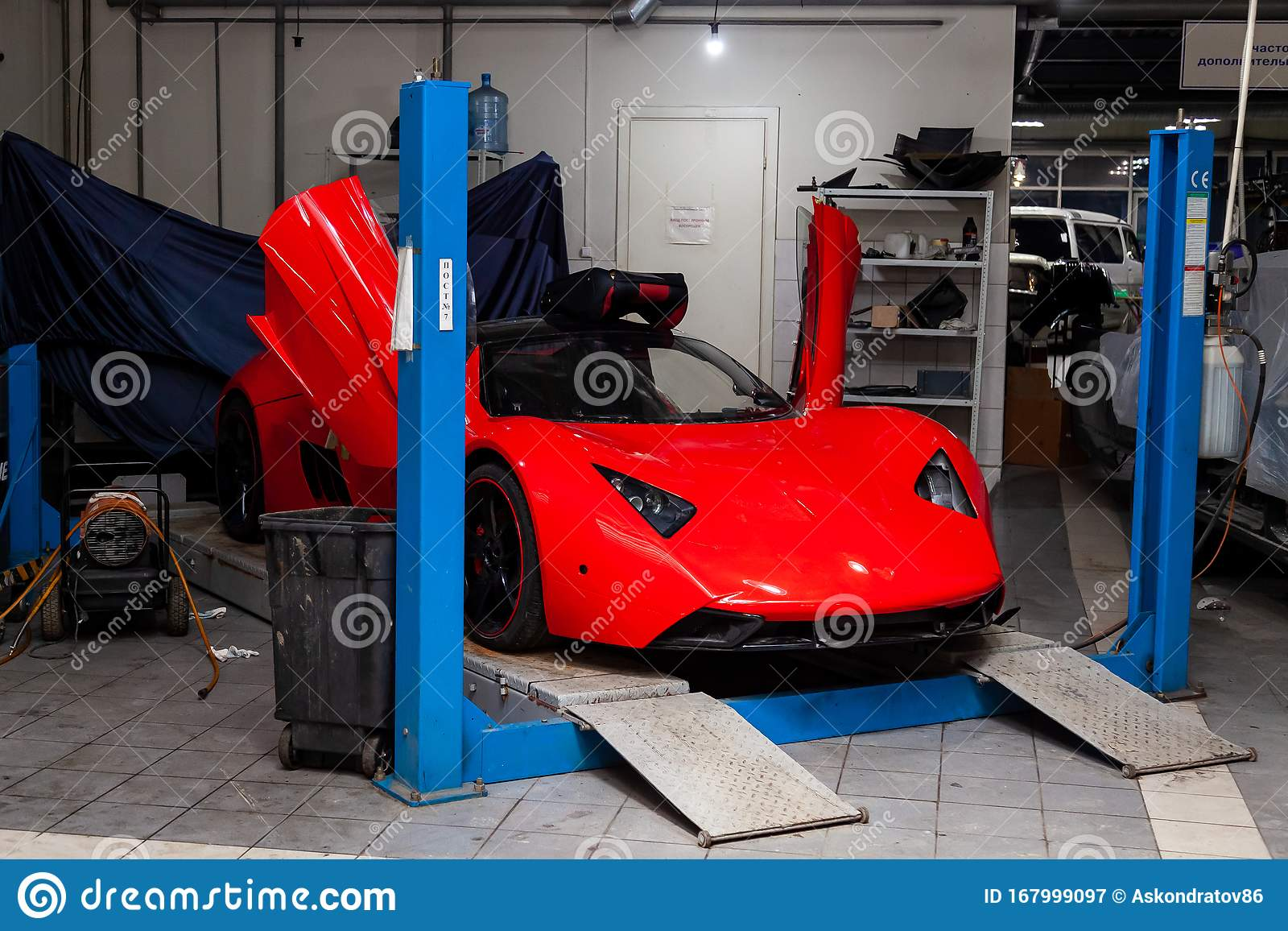 Red Sports Car Marussia B1 Raised On A Lift In A Car ...