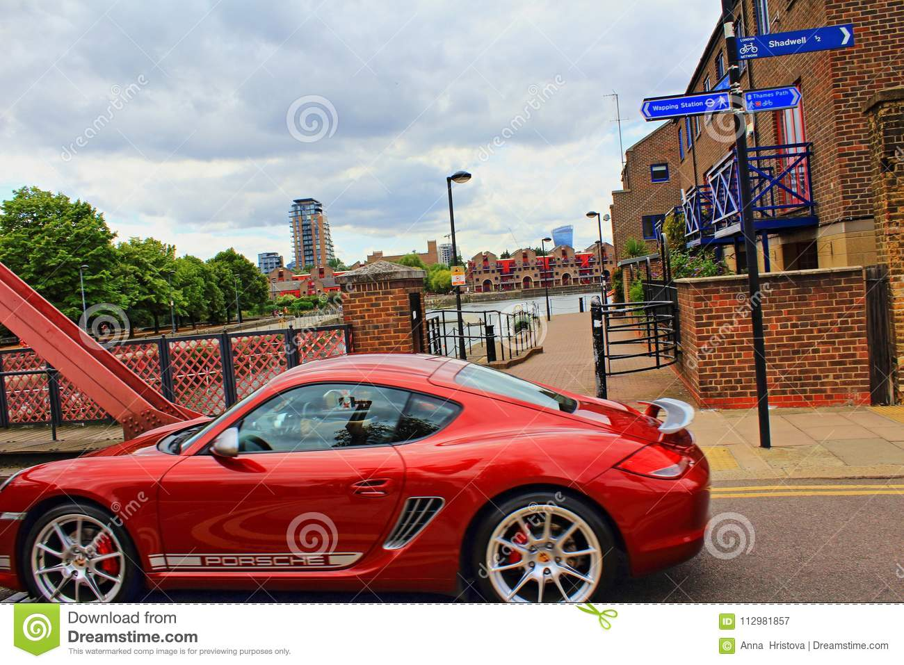 Red bridge red car Wapping Wall Central London Great Britain