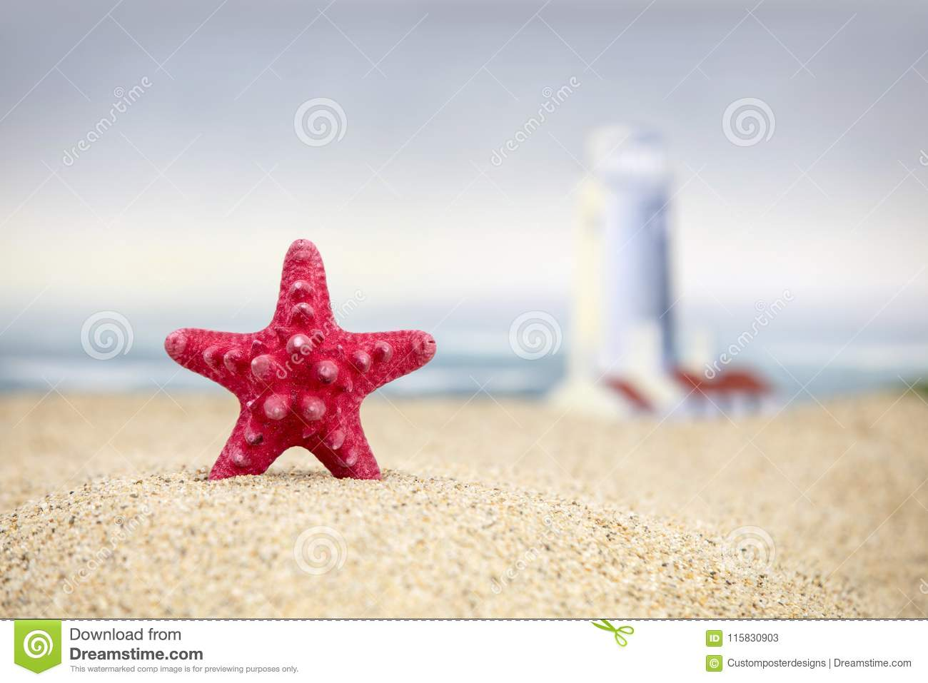 A red starfish and lighthouse at the beach.