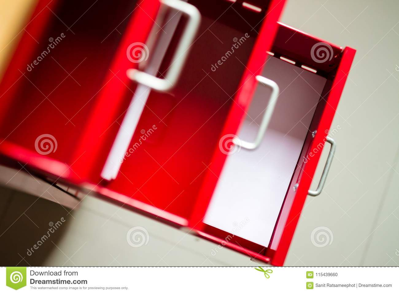 Red steel drawer for documents.
