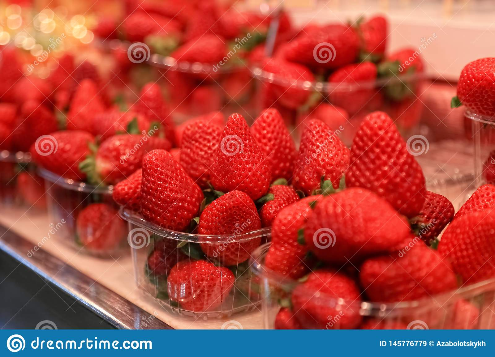 Red strawberries in plastic containers