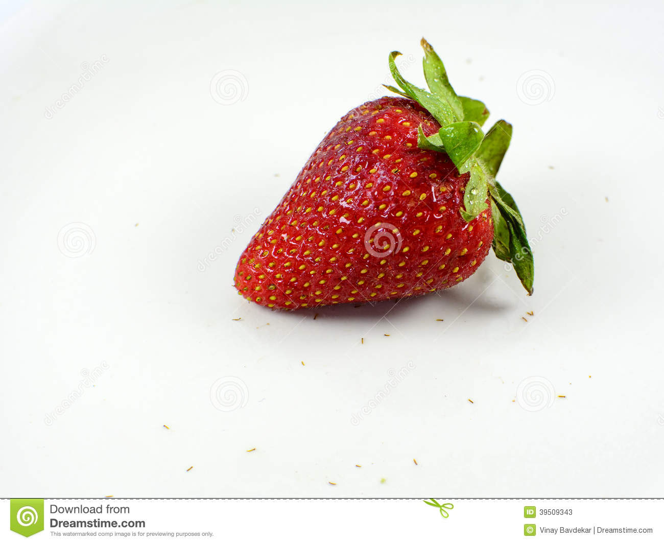A red strawberry on white background