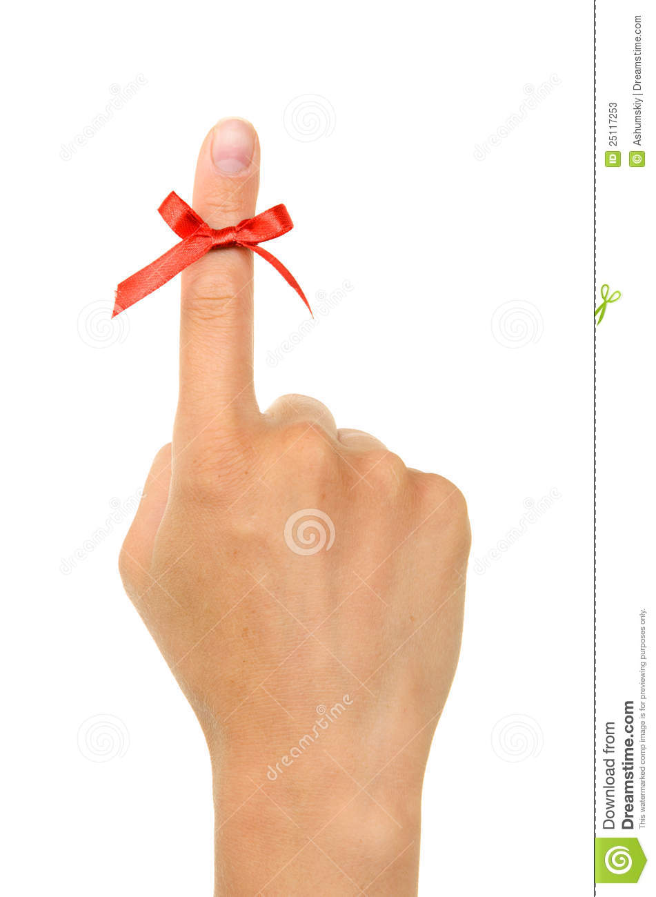 Red string tied around finger as a reminder stock photos image