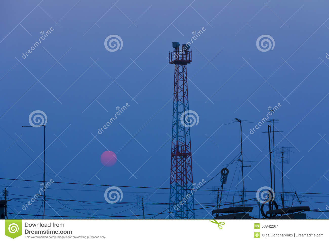 The Red Sun Sets Over The Roof Of A Town House, Wires,antennas,tower ...