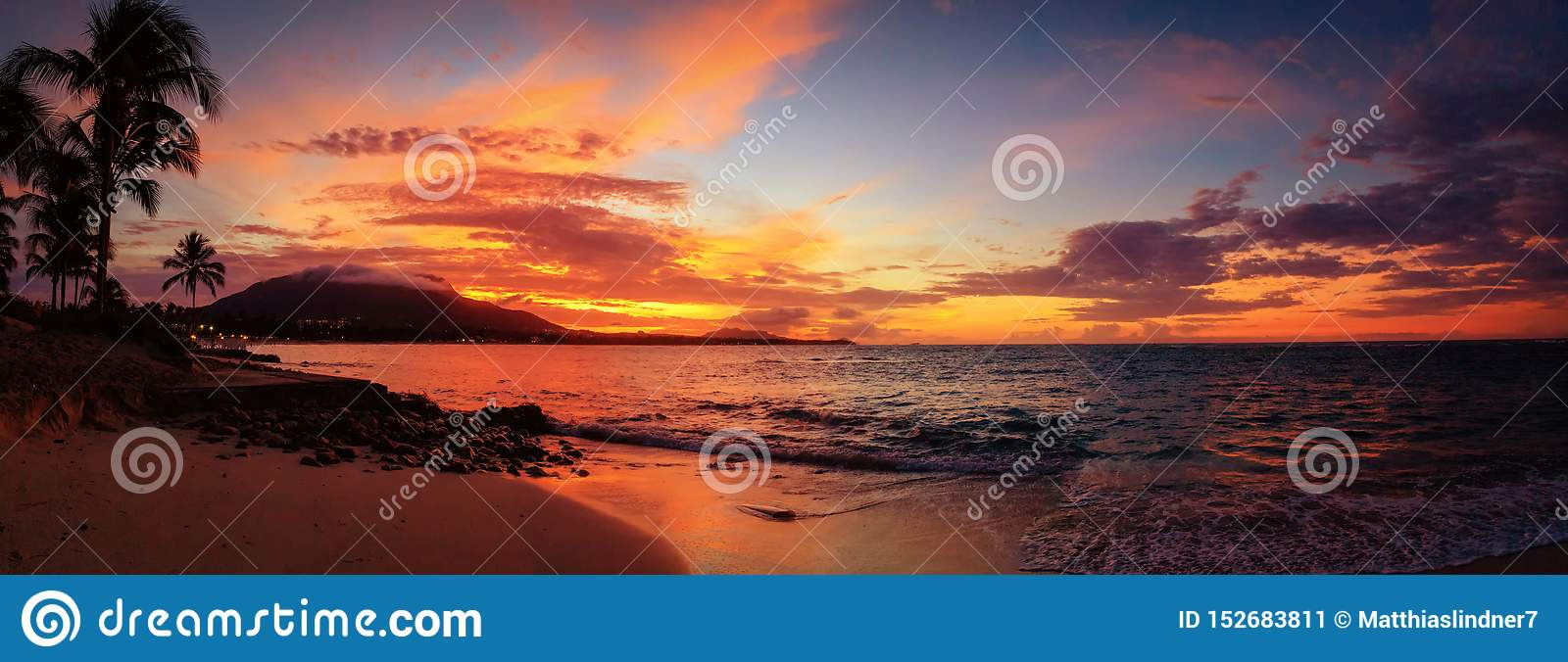 Red sunset panorama on the Caribbean beach with palm trees. Puerto Plata, Dominican Republic, Caribbean