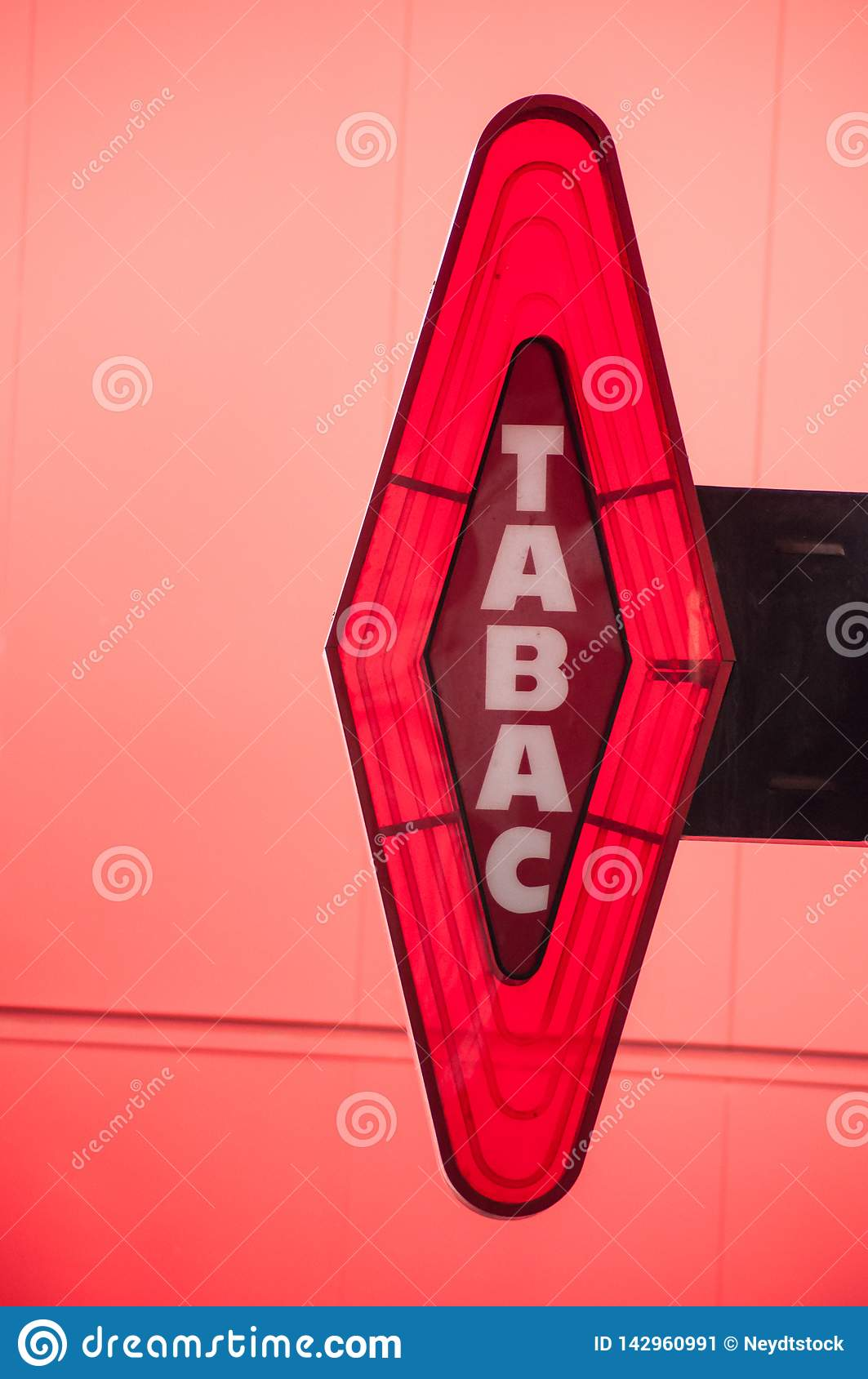 Red Tabacco Sign On Red Background With French Text Tabac The
