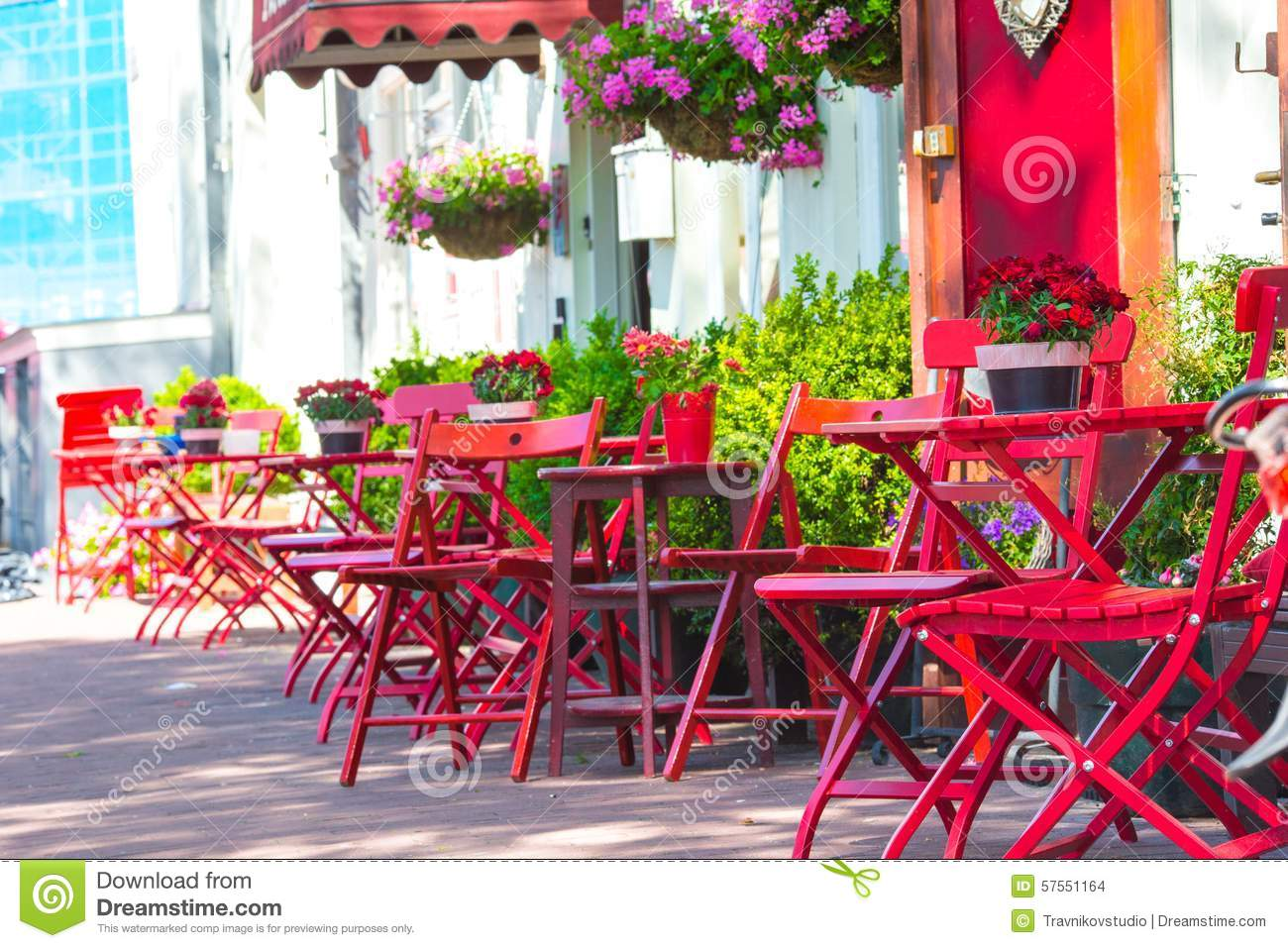 Red Tables And Chairs At A Sidewalk Cafe At Stock Photo