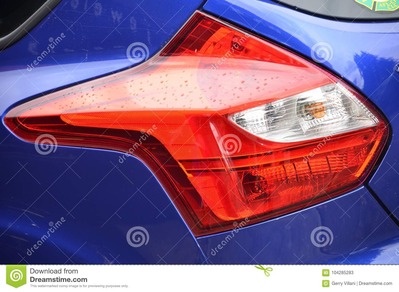 Red Tail Light on Blue Car