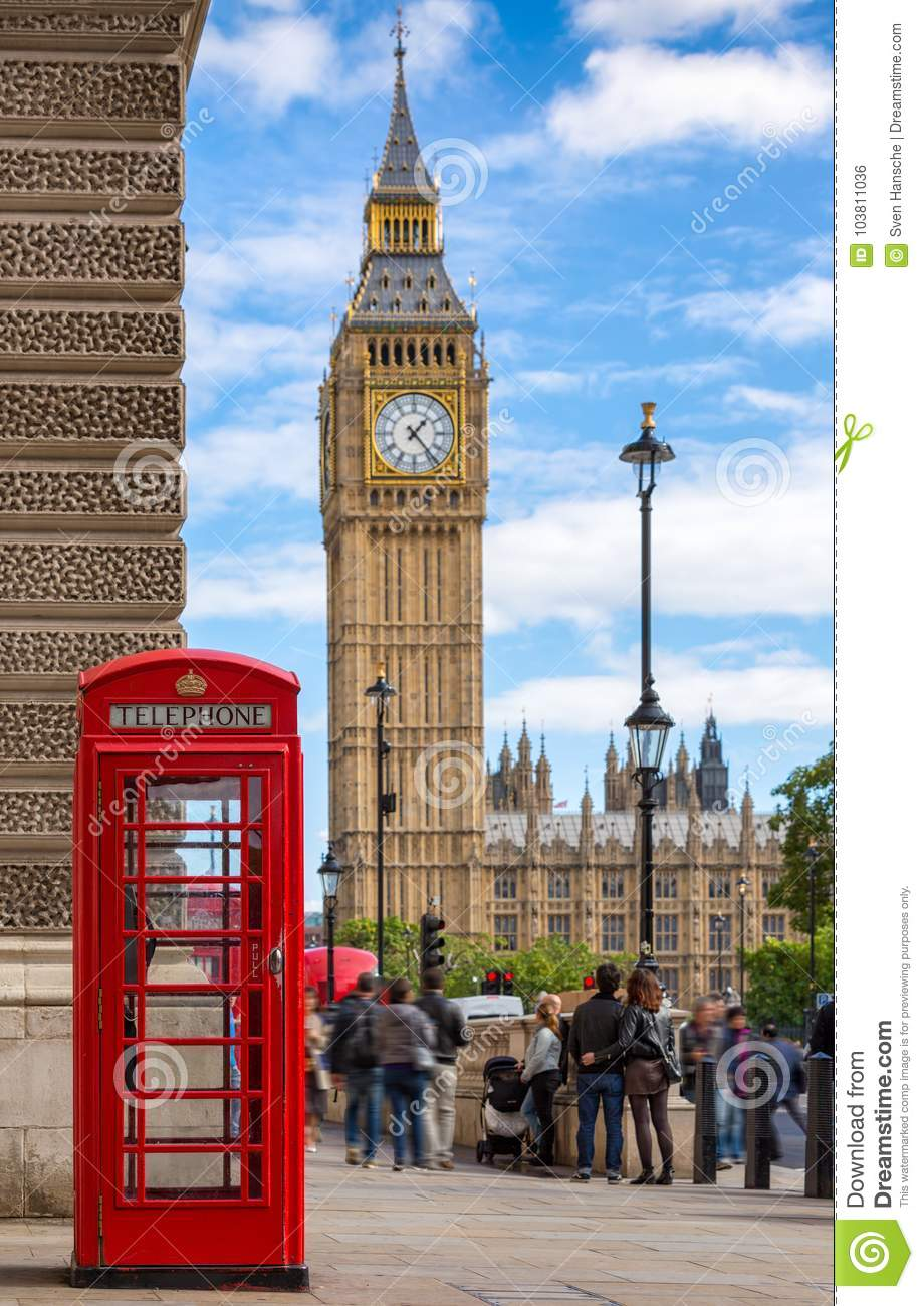 Red telephone booth in front of the Big Ben in London, United Kingdom