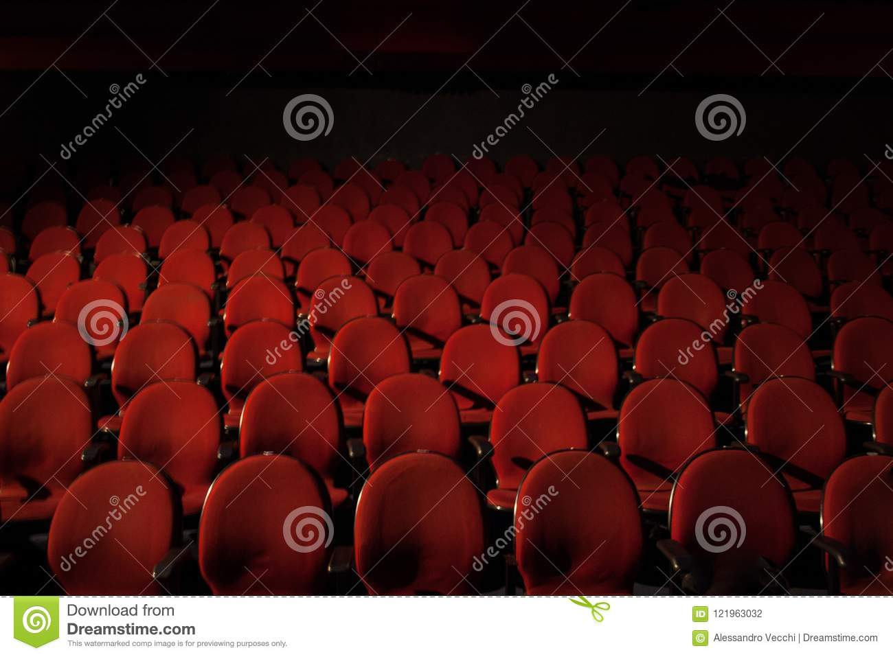 Red Theatre Seats With Black Dark Shadow On The Background