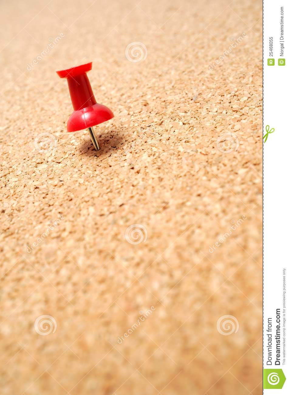 red thumbtack on cork board royalty free stock photo