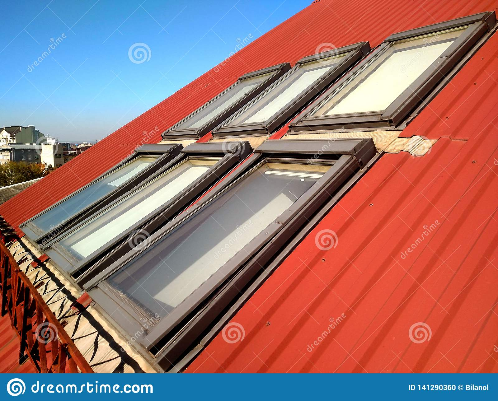Red tiled house roof with attic windows. Roofing construction, window installation, modern architecture concept