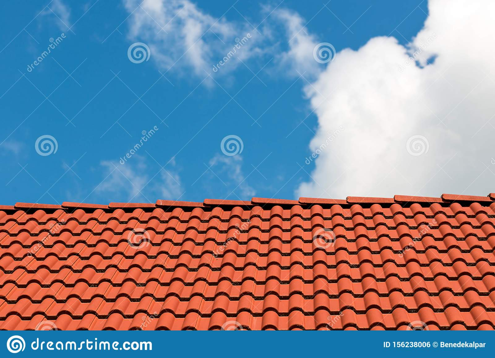 Red tiles on rooftop, beautiful blue sky with white clouds