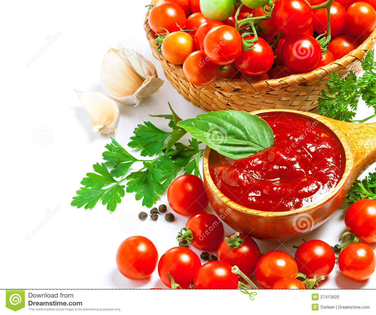 Red tomato sauce in a wooden spoon and ingredients, isolated in white.