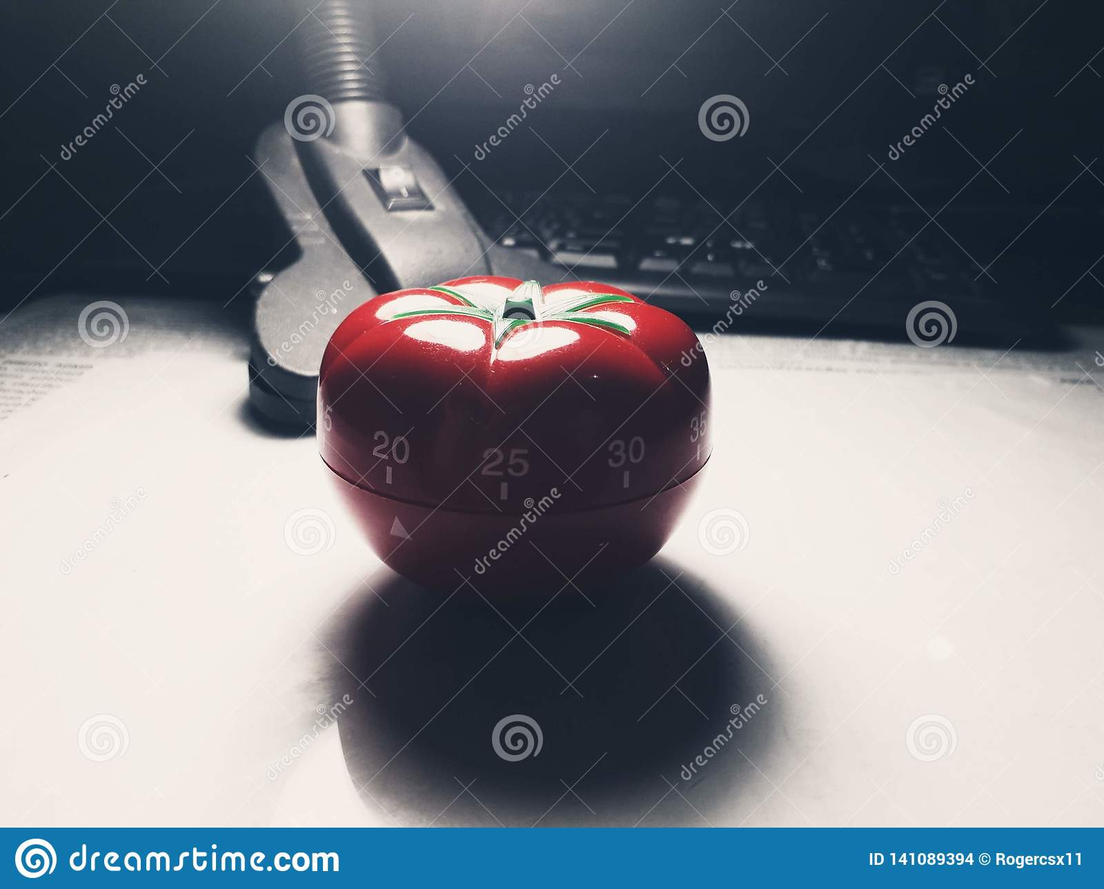 Red tomato shaped kitchen and pomodoro timer.