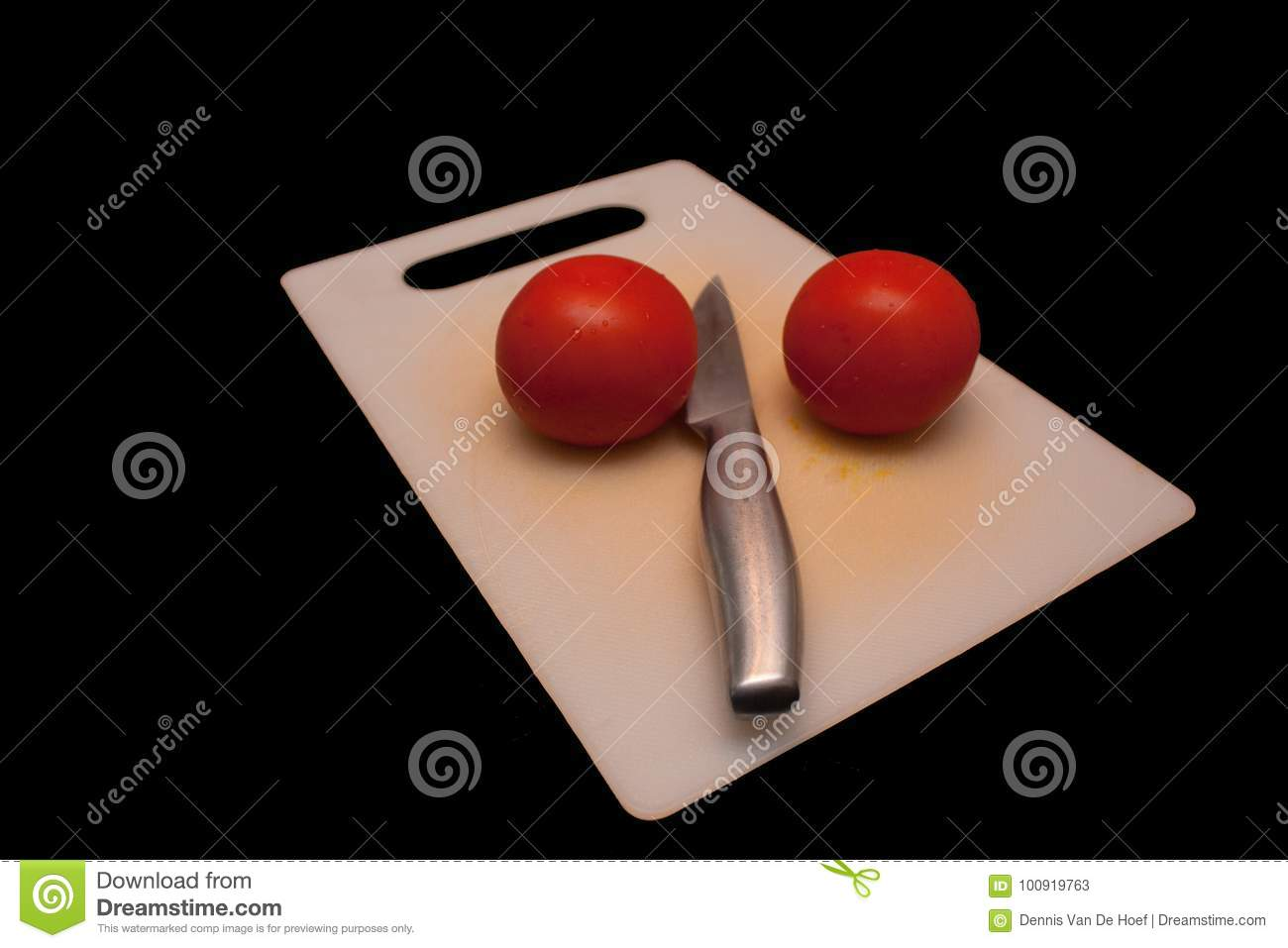 Tomatoes on a cutting board.