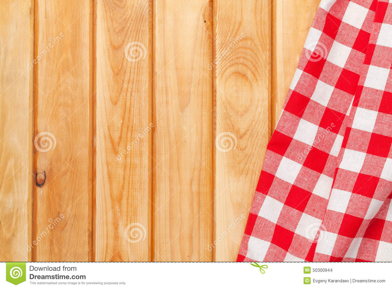 red towel over wooden kitchen table view above copy space 50300944
