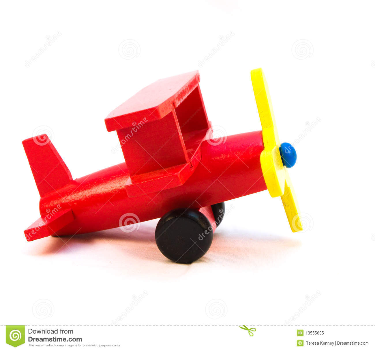 Wooden red toy airplane on a white background that is suitable for a ...