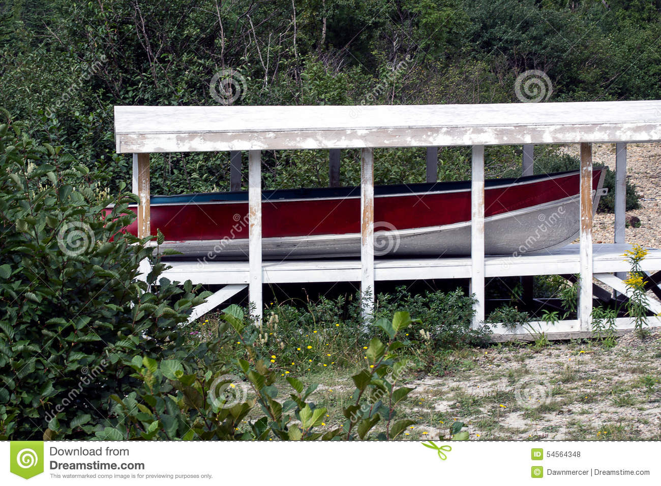 Boat Shelter Plans : Red trim aluminum boat in shelter on beach stock