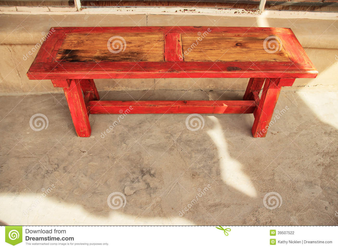 Red trimmed wood bench