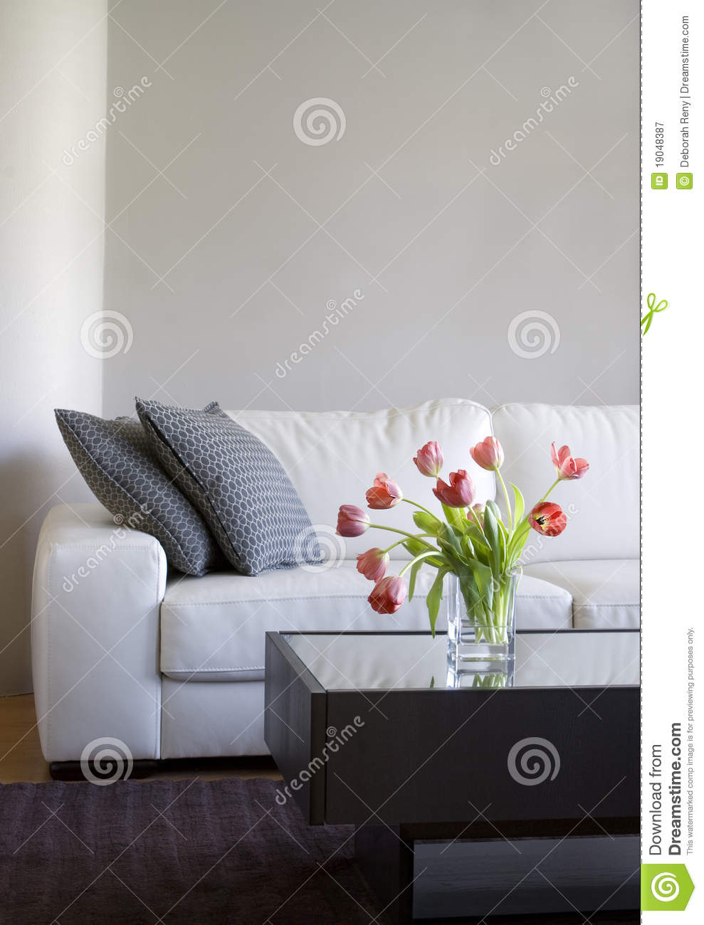 Red tulips in modern living room home decor royalty free for Modern home decor for less