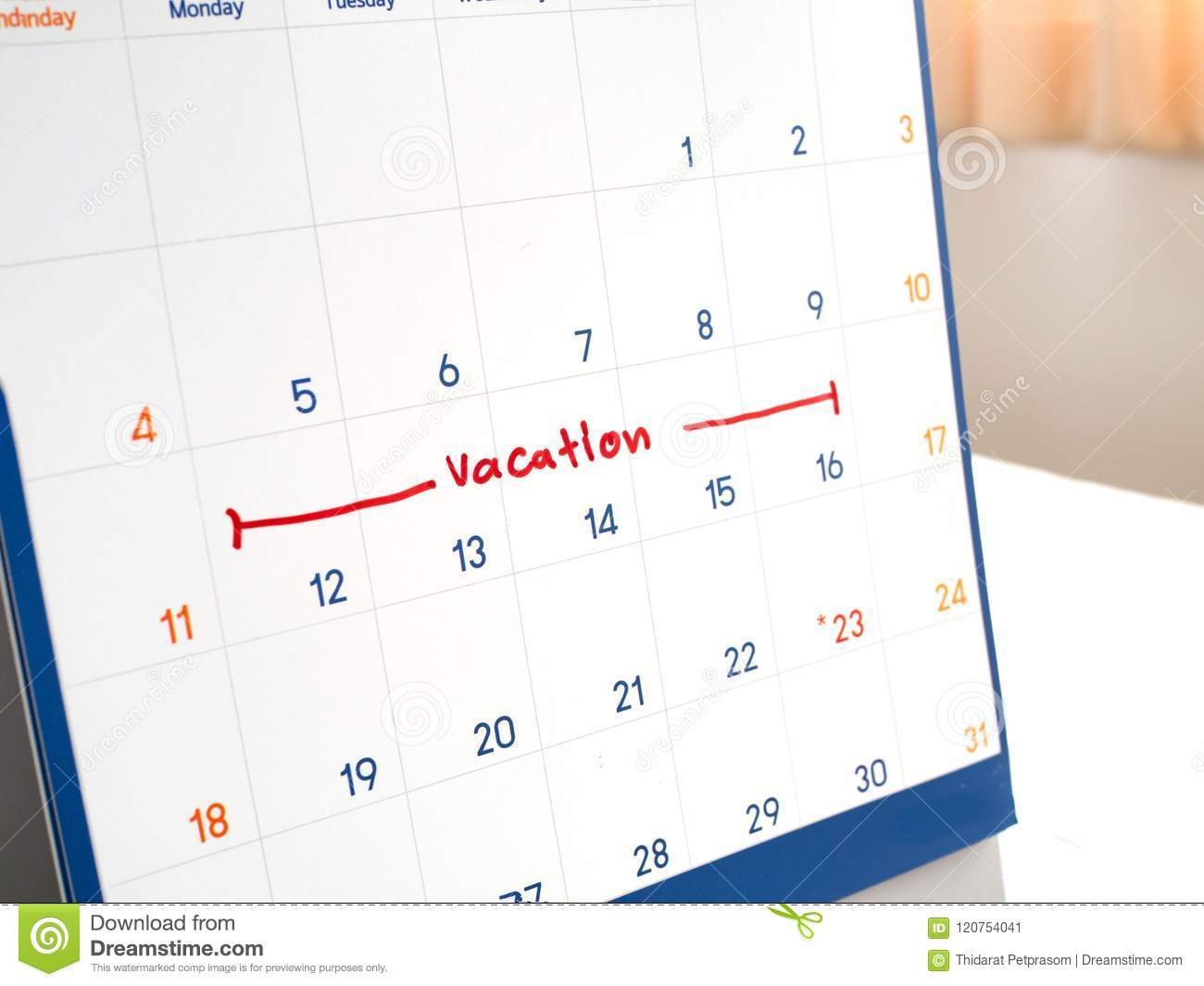 Red vacation write on white calendar marked for remember and target time to long vacation and relax time
