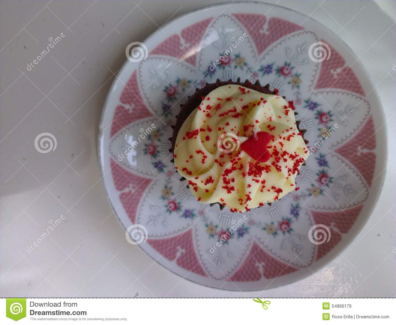... sweet dessert frosting with palable heart design and red sprinkles