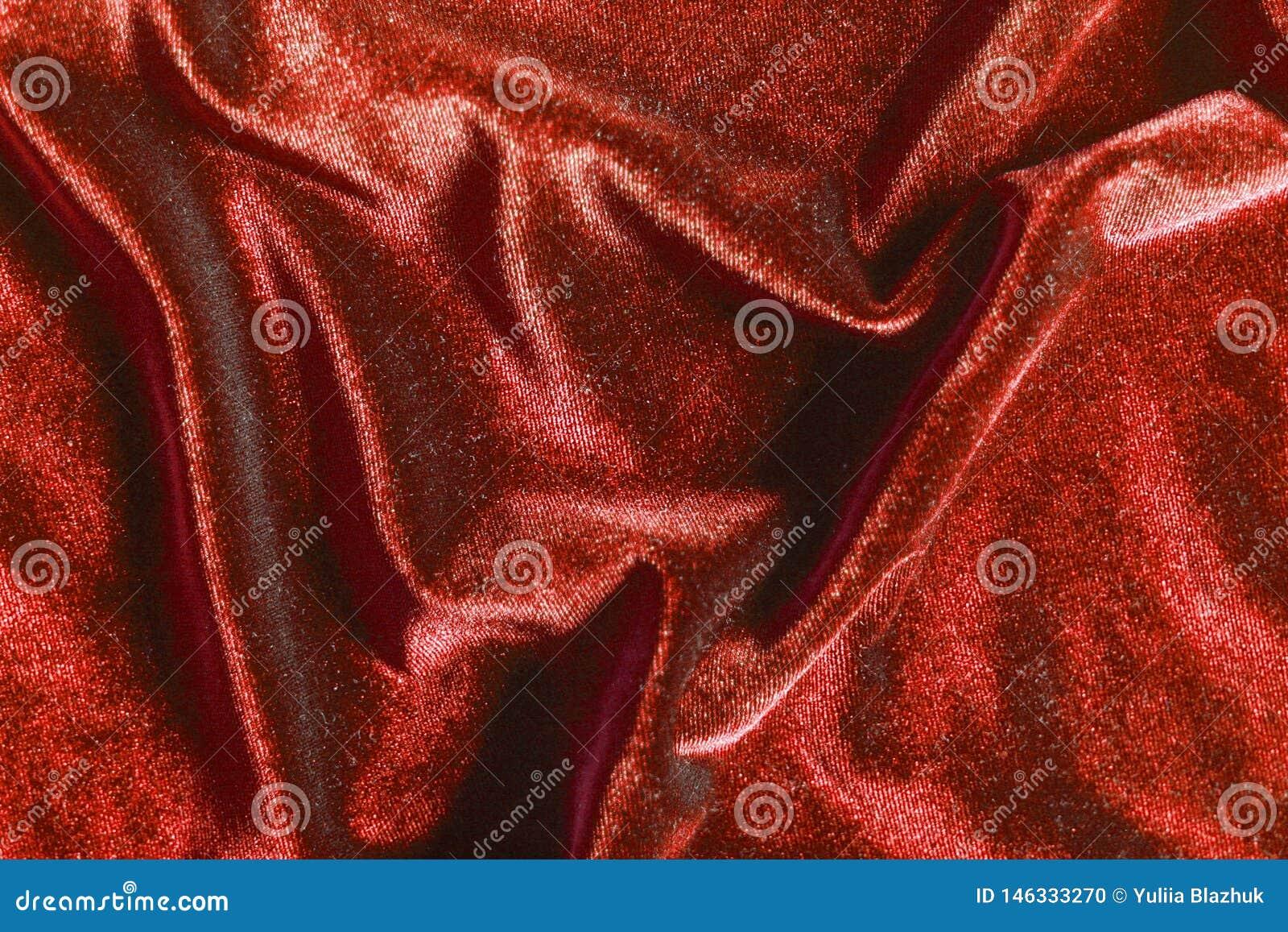 Red velvet folds texture background