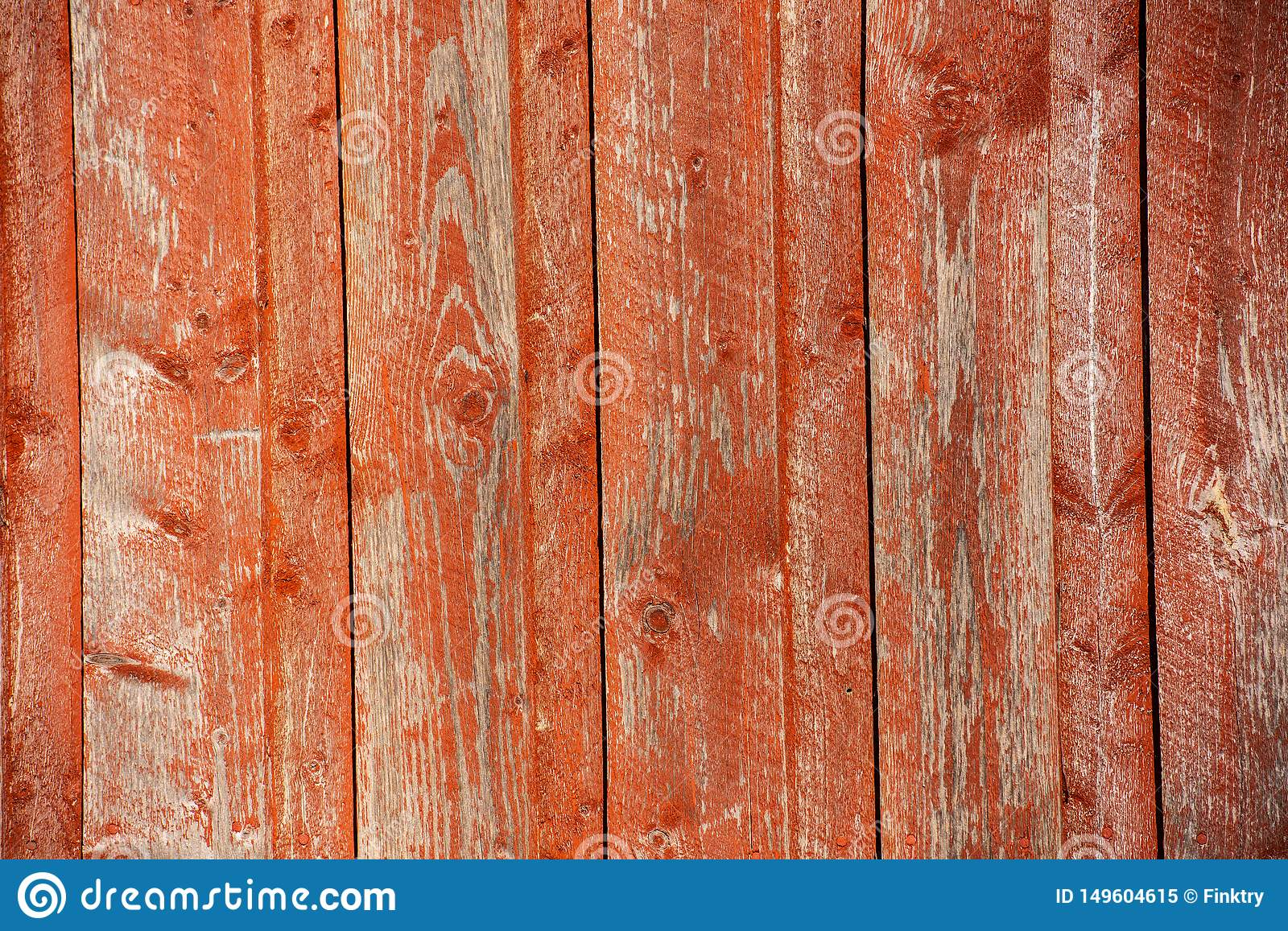 Red vertical wood paneling in sunlight