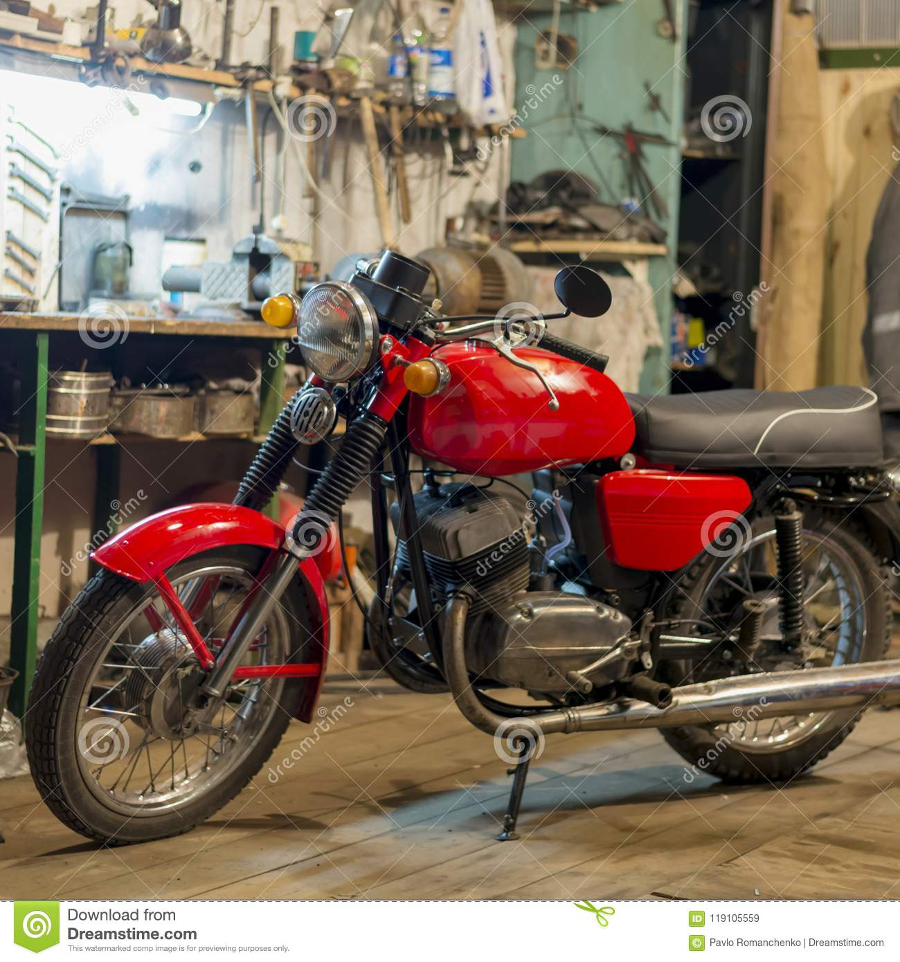 Red Vintage Motorcycle Parked In The Garage Stock Image
