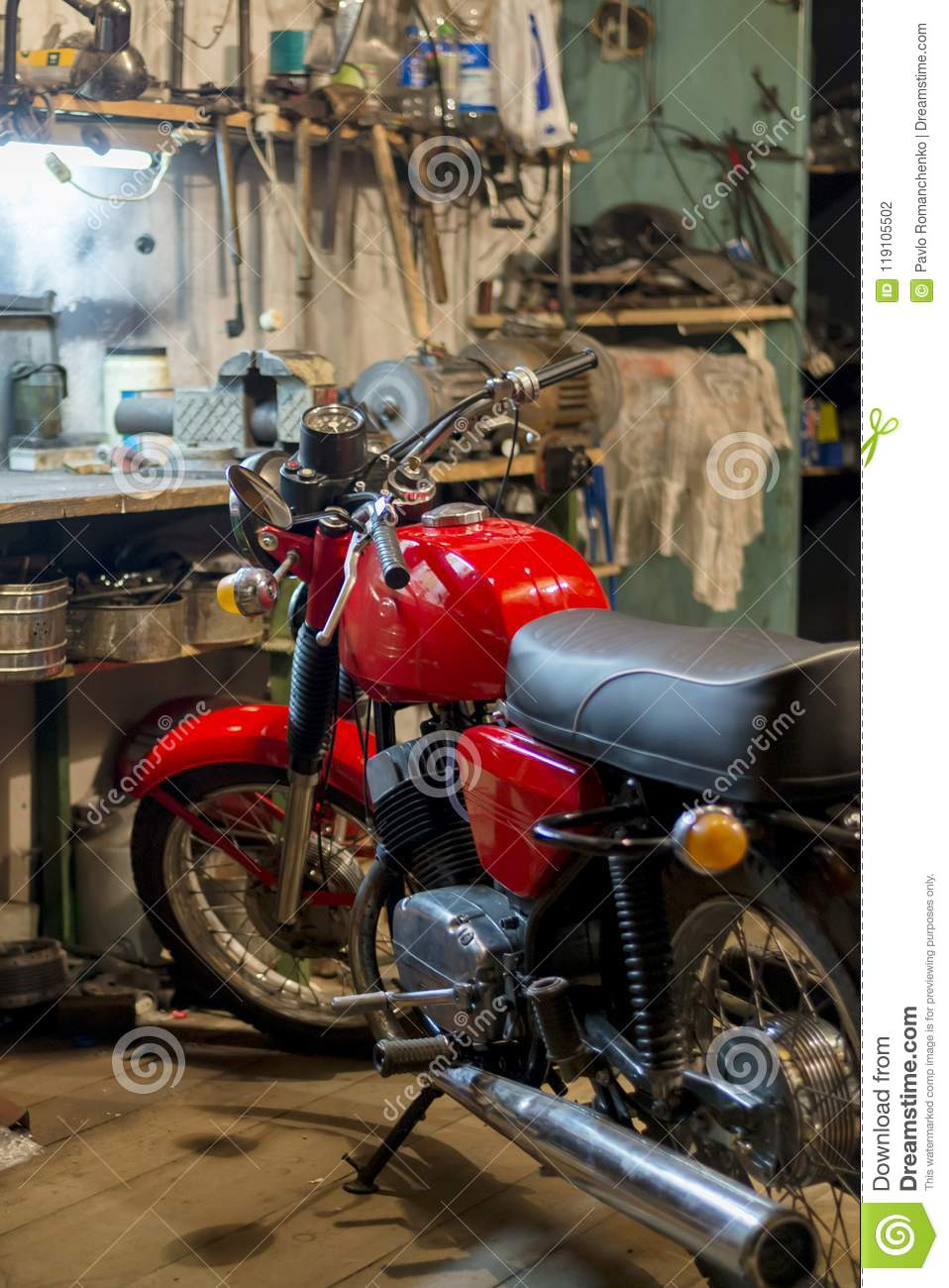 Red Vintage Motorcycle Parked In The Garage Stock Photo