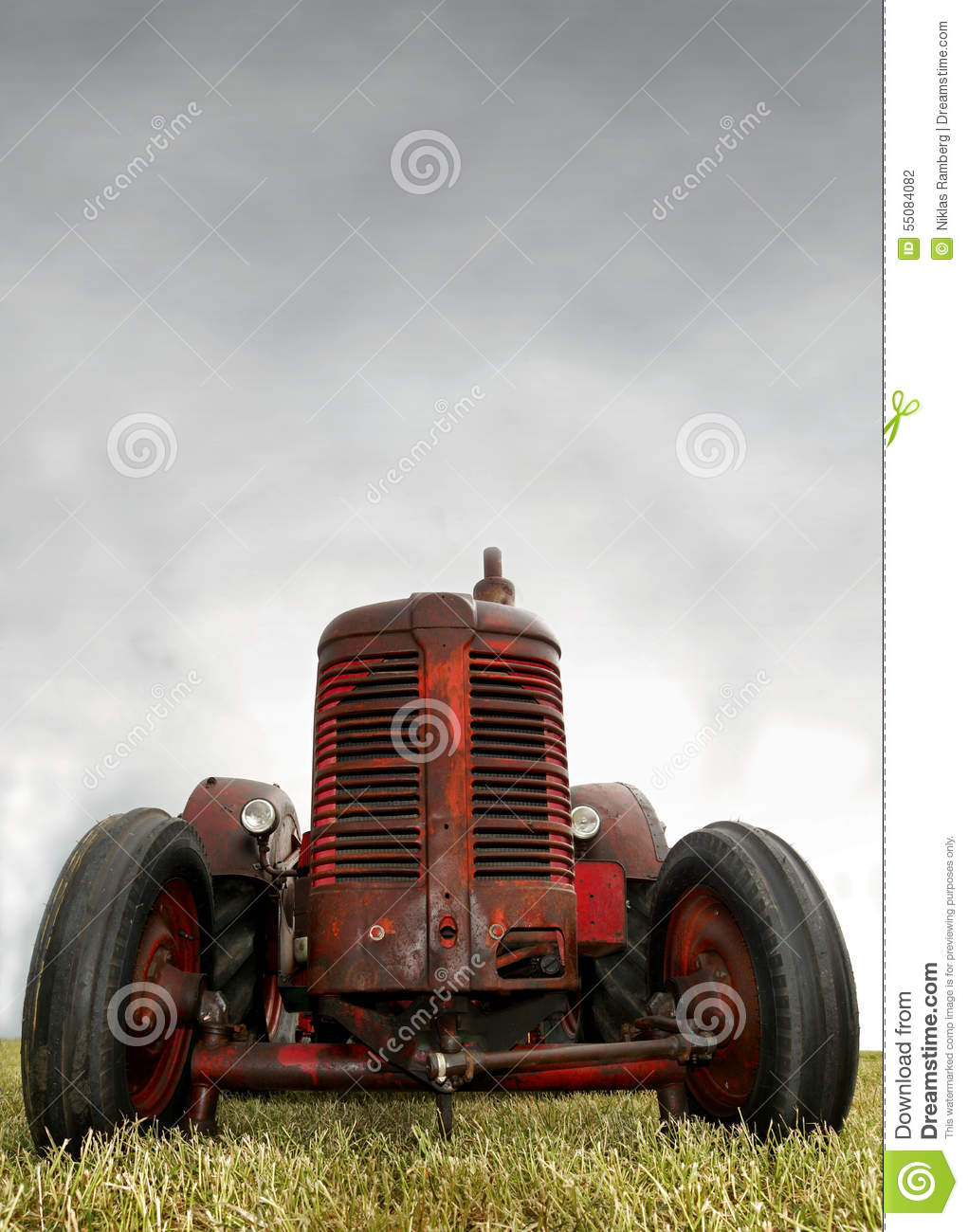 Vintage Tractor Cartoon : Red tractor closeup royalty free stock photography