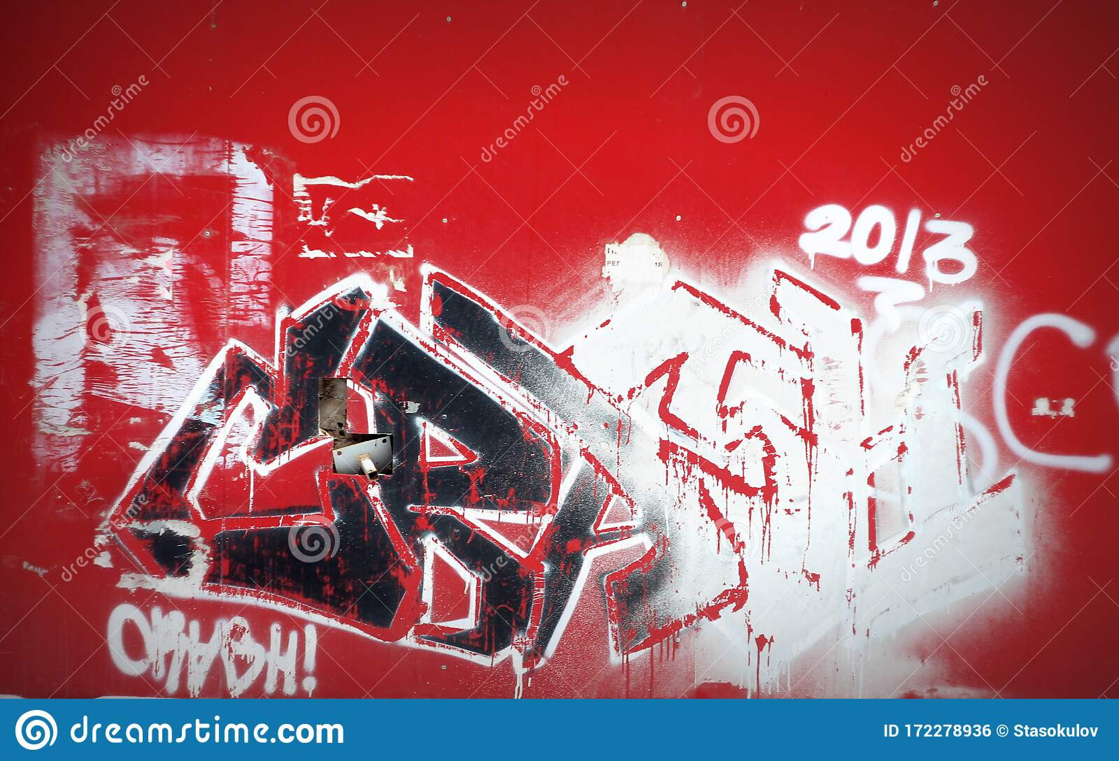 Red Wall With Graffiti Black And White Color Street Art Stock