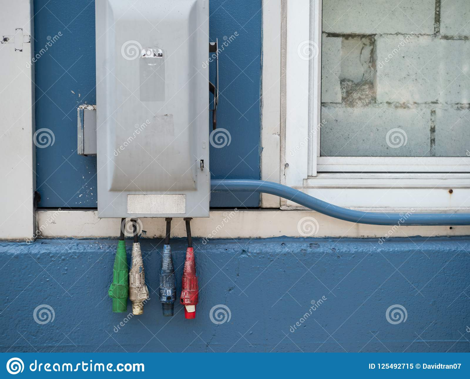 red white blue and red industrial power cables hanging outside of rh  dreamstime com outside ac fuse box outside fuse boxes