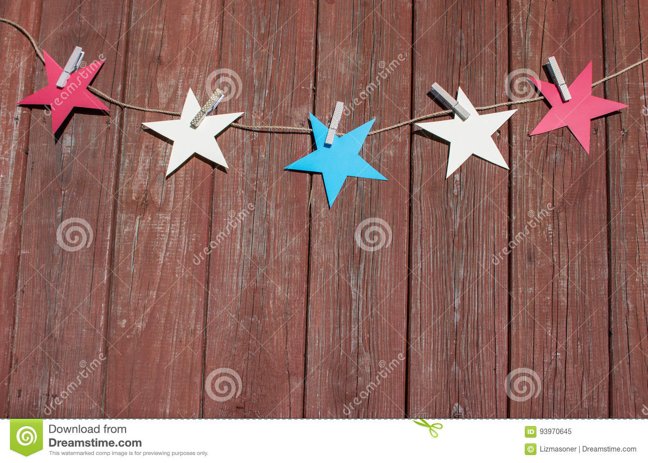 Red White And Blue Stars Hanging From Clothespins Stock Image
