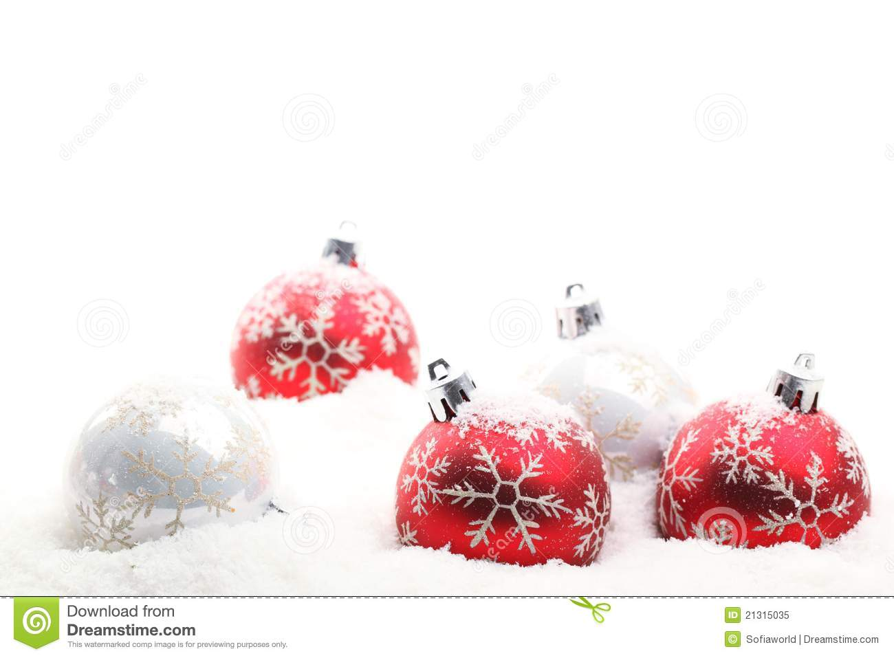 red and white christmas balls in snow flakes stock image