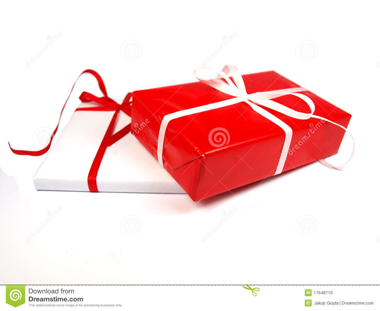 Red and white christmas gifts on background stock