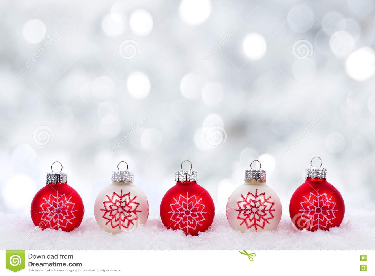 Red and white christmas decorations - Red And White Christmas Ornaments With Twinkling Silver Background Stock Photo