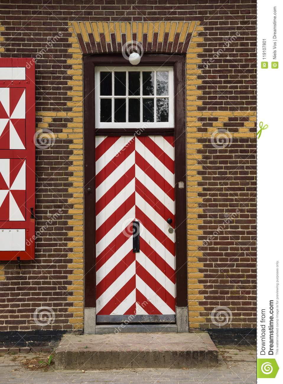 Red And White Decorations On The Doors And Window Shutters