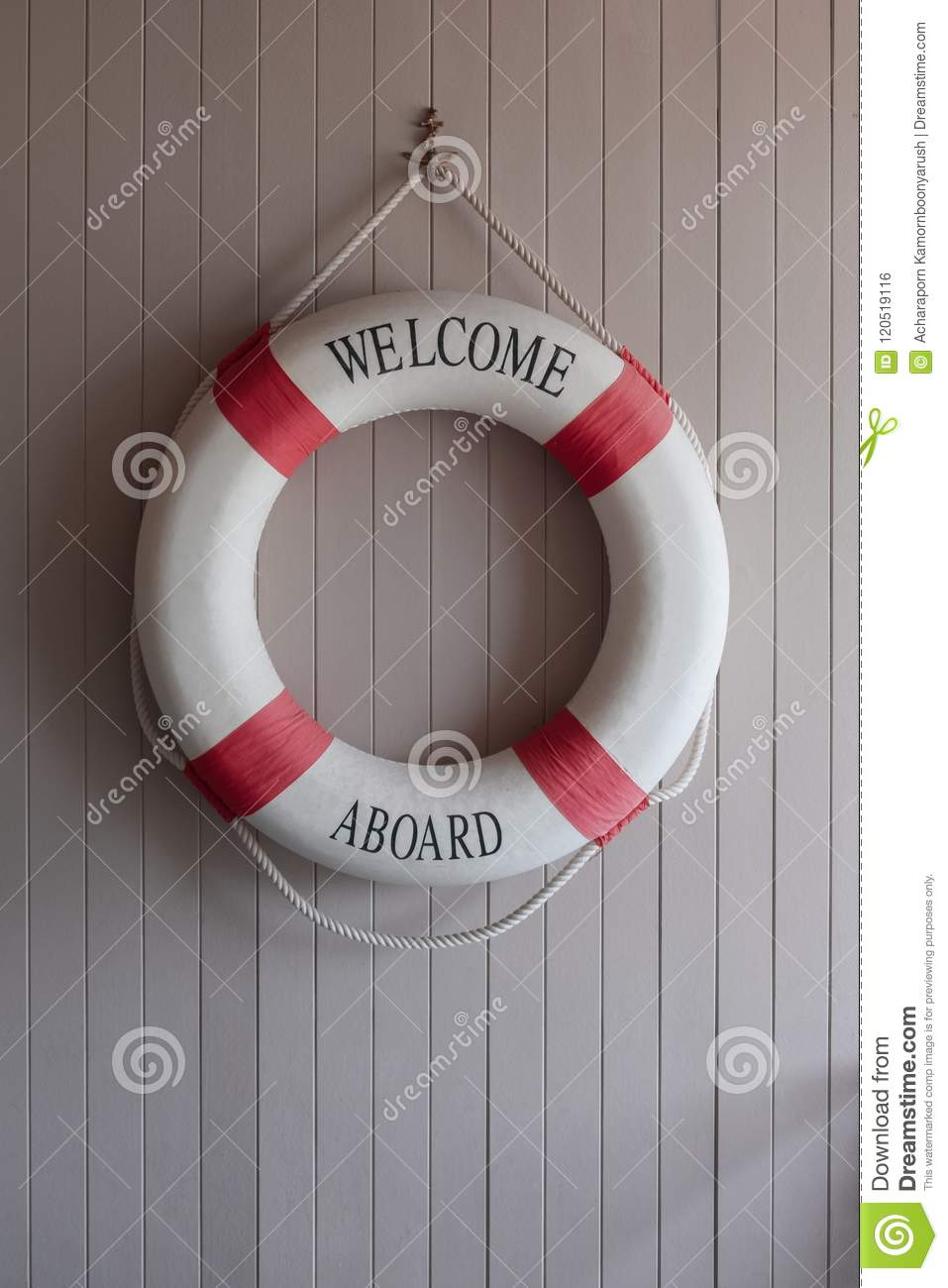 Red-white lifebuoy, safety torus on wooden board