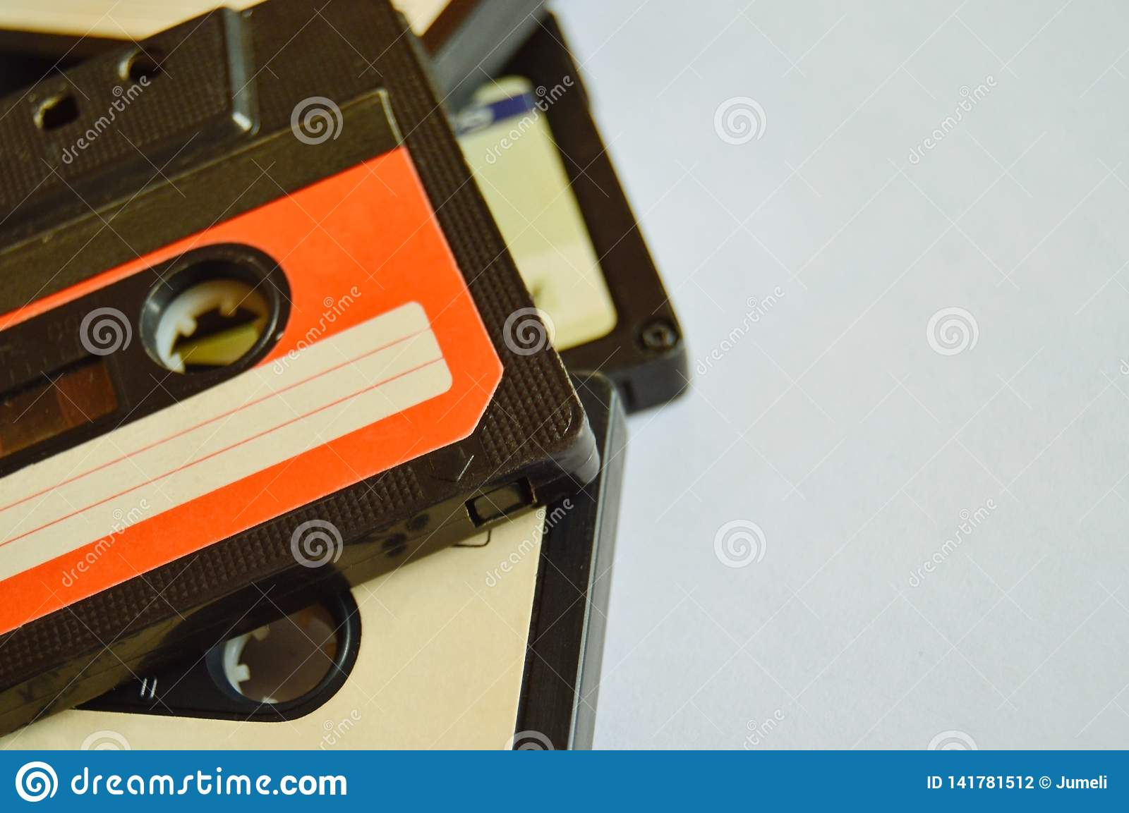 Red and white old audio cassette background with copy space. 80s-90s. Close-up