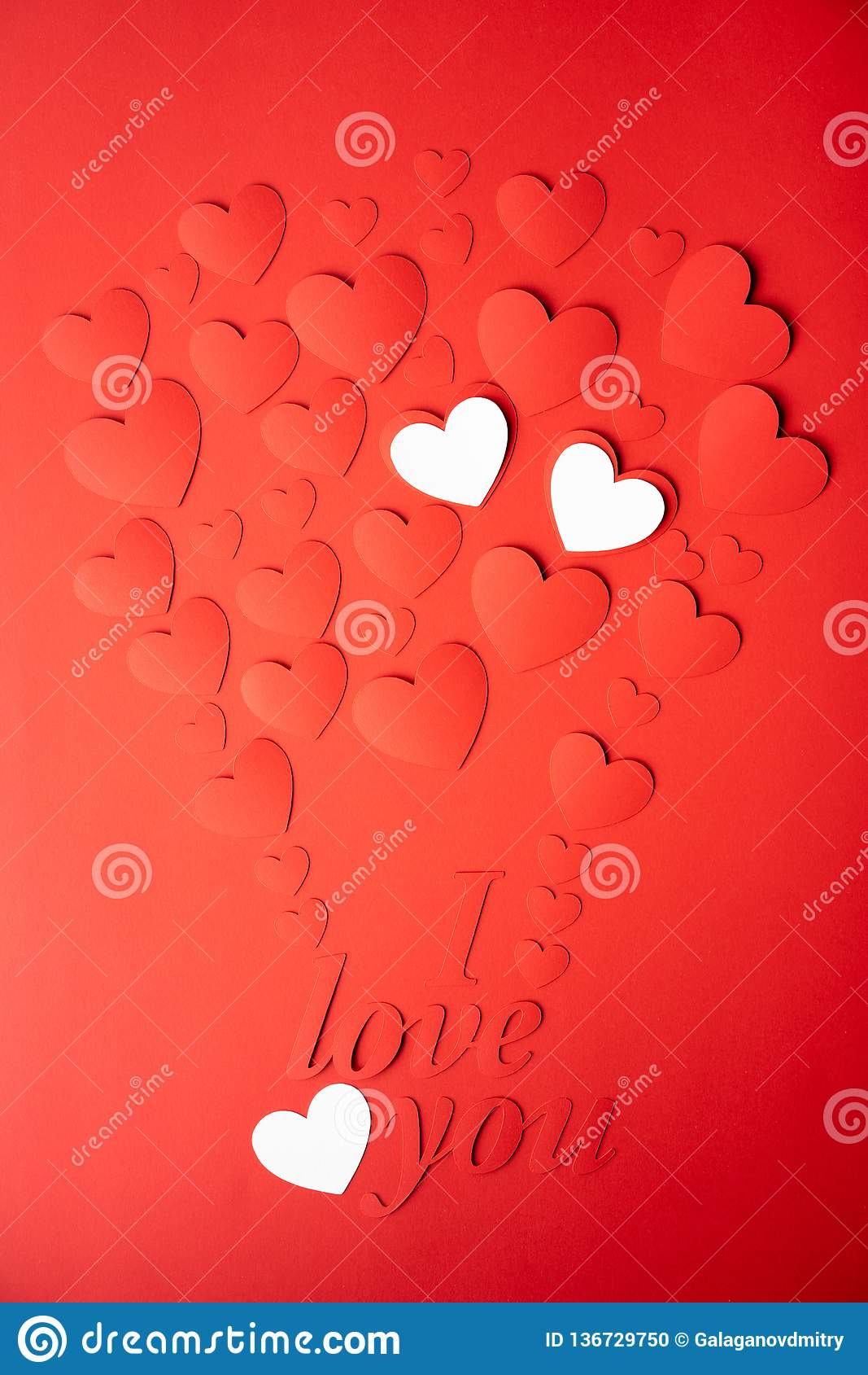 Red and white paper background, cut out hearts are lined up in the shape of a balloon. Words I love you. Set of 4 photos.