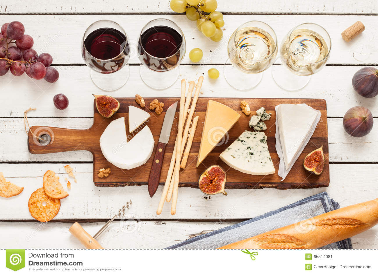 Red and white wine plus different kinds of cheeses (cheeseboard)