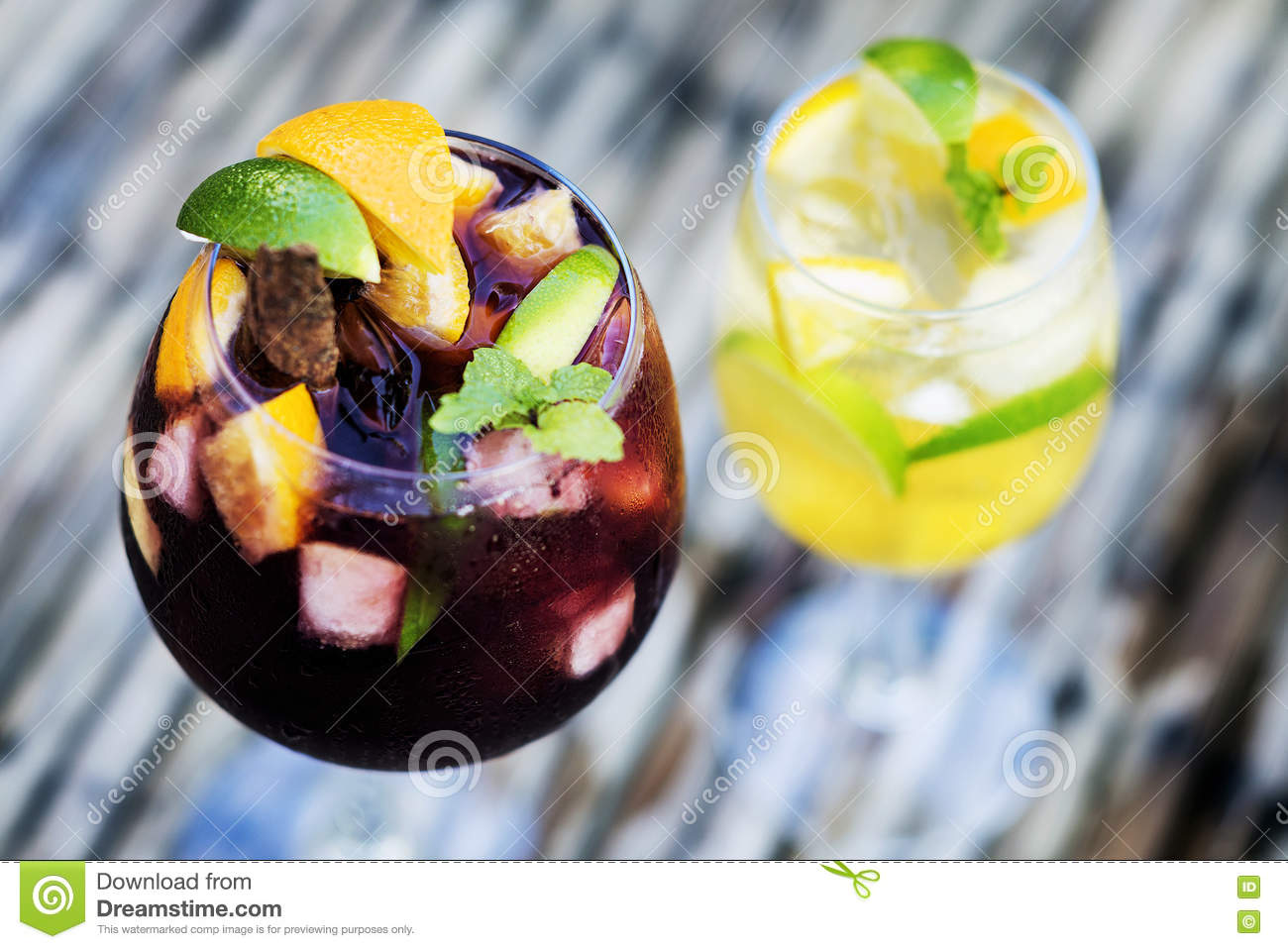 Red and white wine sangria cocktail drinks on table