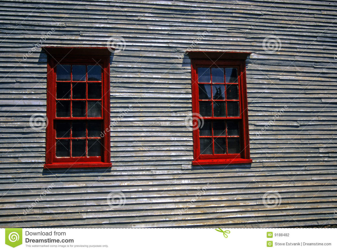 Red Windows On 19th Century Clapboard House Stock