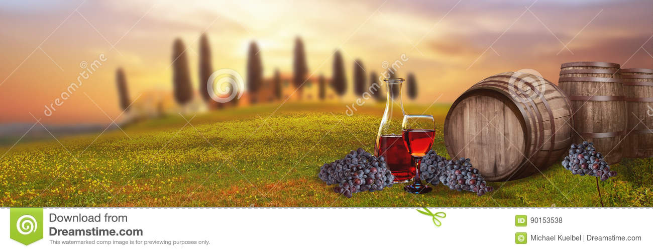 Red wine barrel against Tuscan landscape Italy