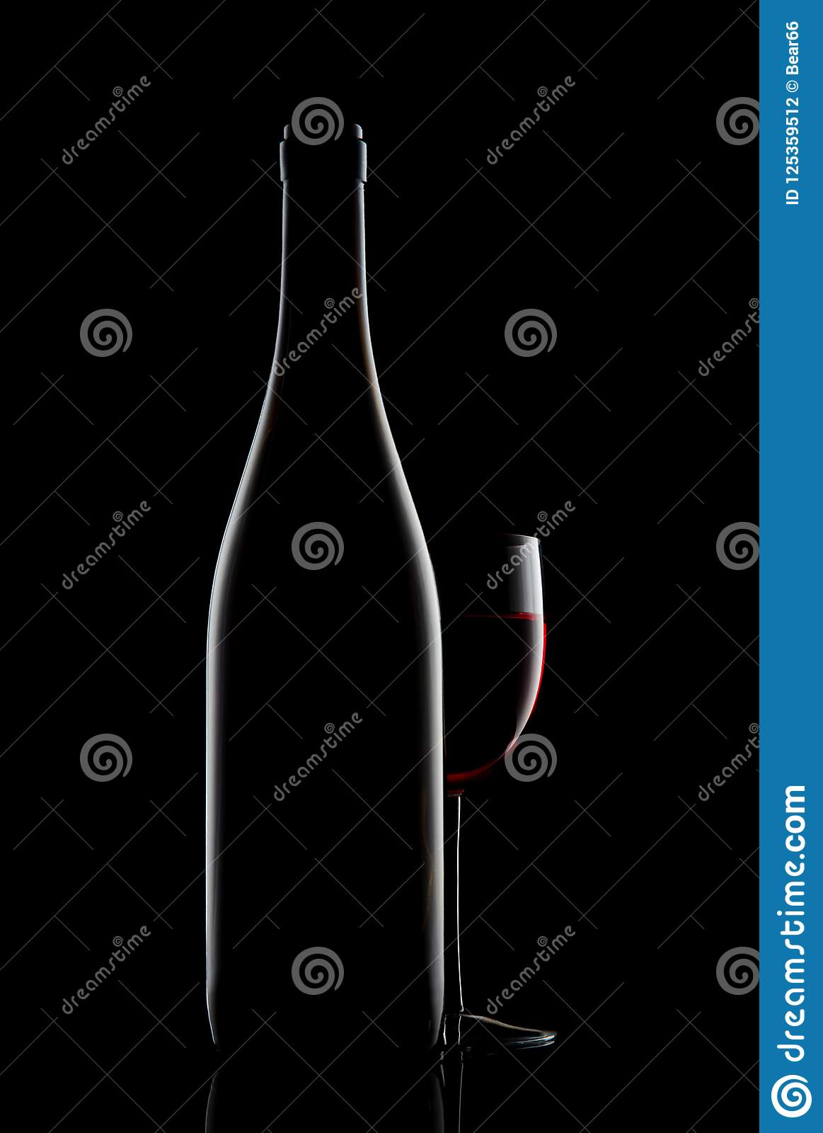Download Red Wine Bottle And Wine Glass On Black Background Stock Photo - Image of alcoholic, lighting: 125359512